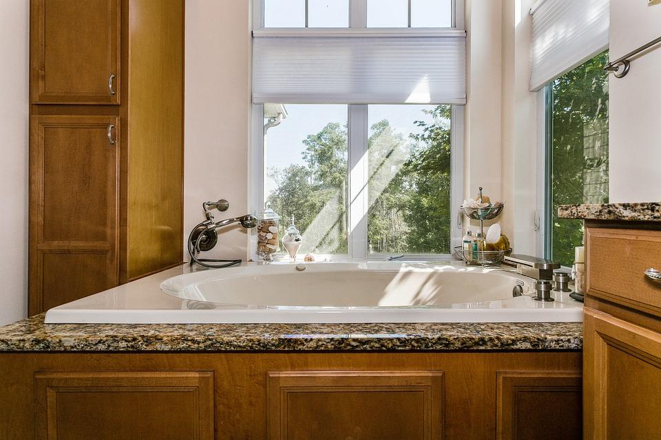 White bathtub near window